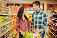 Happy couple flirting at the store Royalty Free Stock Image