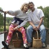 Happy couple on the floodgate Royalty Free Stock Photos