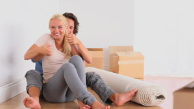Happy couple on the floor. In their livingroom stock footage