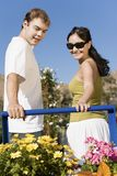 Happy Couple With Flower Plants Stock Images