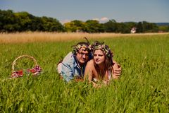 Happy couple with flower's crown Stock Photos