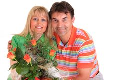 Happy couple with flowers Stock Image