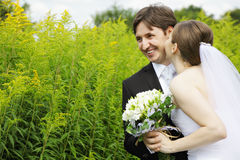 Happy couple with flowers outdoors Stock Image