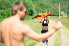Happy couple flying a kite Stock Photos