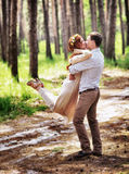 Happy couple in the forest Stock Photography