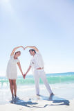 Happy couple forming heart shape with their hands Royalty Free Stock Image