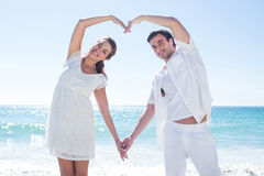 Happy couple forming heart shape with their hands Royalty Free Stock Photos