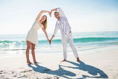 Happy couple forming heart shape with their hands Royalty Free Stock Photography