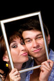 Happy couple in frame. Beautiful young couple Royalty Free Stock Photography
