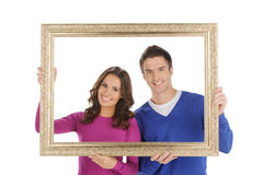 Happy couple in frame. Royalty Free Stock Image