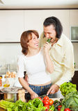 Happy couple with fresh vegetables Royalty Free Stock Image