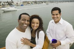 Happy Couple With Friend On Yacht Stock Image