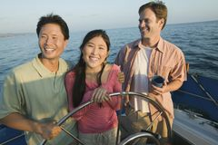 Happy Couple With Friend On The Yacht Stock Photo