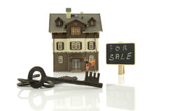 Happy couple in front of house. Happy puppet couple in front of house for sale with the keys stock image