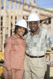 Happy Couple In Front Of Incomplete House royalty free stock photography