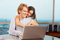 Happy couple in front of laptop Stock Image