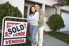 Happy Couple In Front Of New House Royalty Free Stock Image