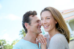 Happy couple in front of their home Royalty Free Stock Photo