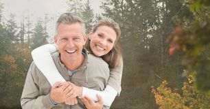 Happy couple in front of trees Royalty Free Stock Images