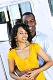 Happy couple in front of yacht stock images