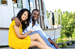 Happy couple in front of yacht Stock Photos