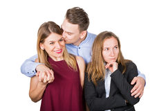 Happy couple & frustrated ex girlfriend Royalty Free Stock Image