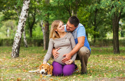 Happy couple of future parents on the walk Royalty Free Stock Photo