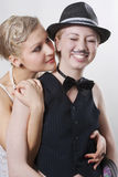 Happy couple of gangsters. Couple of gangsters, one of girls is made up under the man Royalty Free Stock Photography