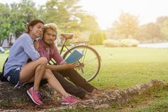 Happy couple in the garden. In the morning Royalty Free Stock Photo
