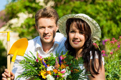 Happy couple gardening in summer Royalty Free Stock Images