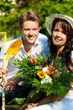 Happy couple gardening in summer Royalty Free Stock Photo