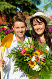 Happy couple gardening in summer Stock Photography