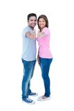 Happy couple gesturing thumbs up and looking at camera Royalty Free Stock Photos