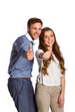 Happy couple gesturing thumbs up Stock Photos