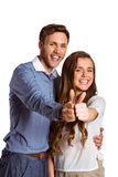 Happy couple gesturing thumbs up Royalty Free Stock Images