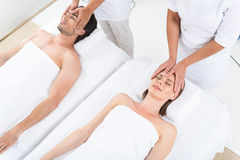 Happy couple getting massage at sp Royalty Free Stock Photos