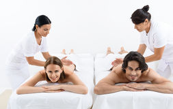 Happy couple getting massage at spa Stock Photography