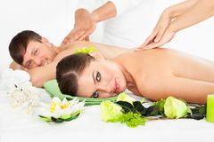 Happy couple getting spa treatment Stock Images