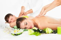 Happy couple getting spa treatment Stock Photography