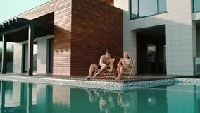 Couple getting sunbathe in luxury apartments. Beautiful people drinking cocktail. Happy couple getting sunbathe in luxury apartments. Beautiful people drinking stock video