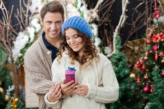 Happy Couple With Gift Box At Christmas Store Stock Images