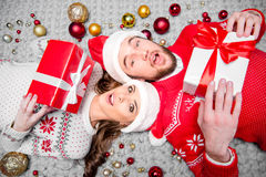 Happy couple with gift boxes Stock Image
