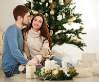 Happy couple with gifts on background of Christmas tree Royalty Free Stock Image