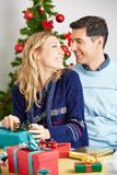 Happy couple with gifts for christmas royalty free stock photography