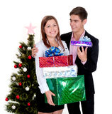 Happy couple with gifts for Christmas Stock Photo