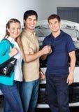 Happy Couple Giving Car Keys To Technician Stock Image