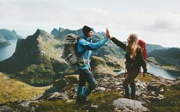 Happy couple giving five hands hiking with backpack royalty free stock images