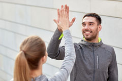 Happy couple giving high five outdoors Royalty Free Stock Photos