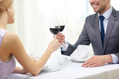 Happy couple with glasses of wine at restaurant Royalty Free Stock Photos