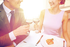 Happy couple with glasses of wine at restaurant Royalty Free Stock Photo